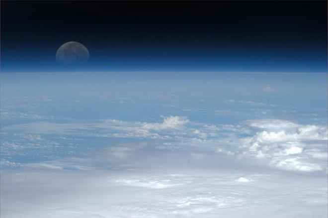 Our Moon, tinted blue, made so by the wisp of Earth's atmosphere.  (Photo & Caption: Col. Chris Hadfield, NASA)