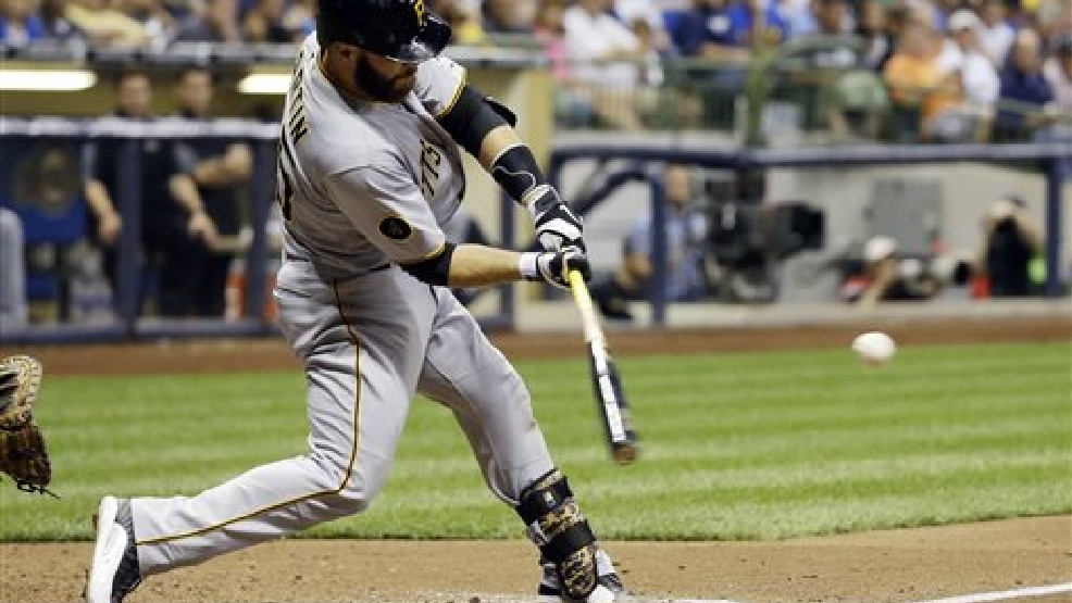Pittsburgh Pirates' Russell Martin hits a three-run home run during the fifth inning of a baseball game against the Milwaukee Brewers pm Saturday, Aug. 23, 2014, in Milwaukee. (AP Photo/Morry Gash)