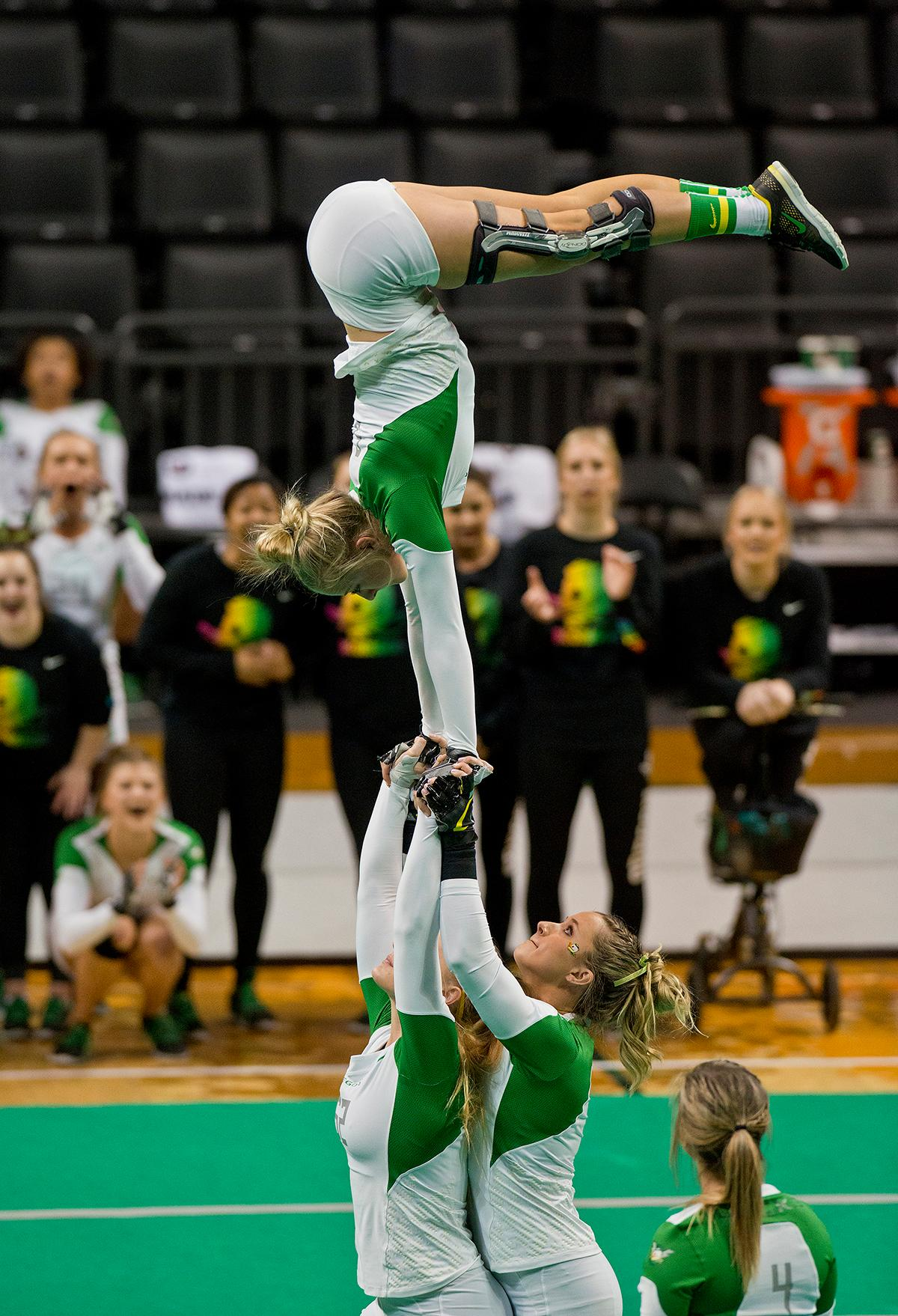 The Oregon Ducks Acro and Tumbling Team led in all six event categories and defeated Fairmont St . Falcons 288.425 to 272.270 in Matthew Knight Arena Friday night. The next home meet for the Ducks will be against Azusa Pacific on April 8th. Photo by Dan Morrison, Oregon News Lab