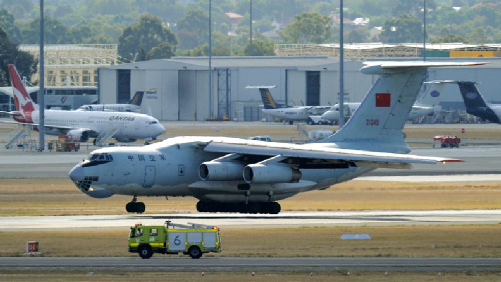 A Chinese Ilyushin IL-76 aircraft returns to Perth, Australia, International Airport Wednesday, April 16, 2014, to assist in the search for the missing Malaysia Airlines Flight 370 in the southern Indian Ocean. A robotic submarine looking for the lost Malaysian jet is continuing its second seabed search as up to 14 planes were to take to the skies for some of the final sweeps of the Indian Ocean for floating debris from the ill-fated airliner. (AP Photo/Greg Wood, Pool)