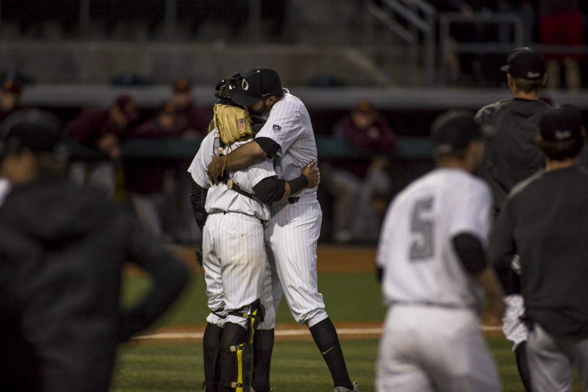 Oregon Ducks pitcher David Peterson (#3) celebrates with catcher Tim Susnara (#6) after throwing the game winning pitch. The Oregon Ducks defeated the Arizona State Sun Devils 2-0 in the first game of a three game series Friday evening at PK Park in Eugene, Oregon. Photo by Duncan Moore, Oregon News Lab.