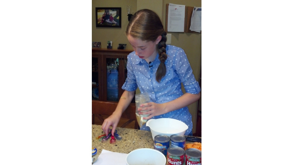 Sarah Ganser, 12, prepares a recipe at her Appleton home, July 8, 2014. (WLUK/Kelly Schlicht)
