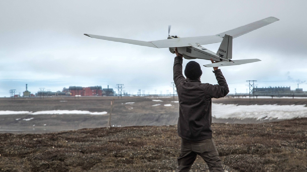 In this photo taken Saturday, June 7, 2014, and released by BP Alaska, Unmanned Aerial System (UAS) technology using an AeroVironment Puma drone is given a pre-flight checkout in preparation for flights by BP at its Prudhoe Bay, Alaska operations. The Federal Aviation Administration said Tuesday it has granted the first permission for commercial drone flights over land, the latest effort by the agency to show it is loosening restrictions on commercial uses of the unmanned aircraft. Drone maker AeroVironment of Monrovia, California, and BP energy corporation have been given permission to use a Puma drone to survey pipelines, roads and equipment in Alaska, the agency said. The first flight took place on Sunday. (AP Photo/BP Alaska)