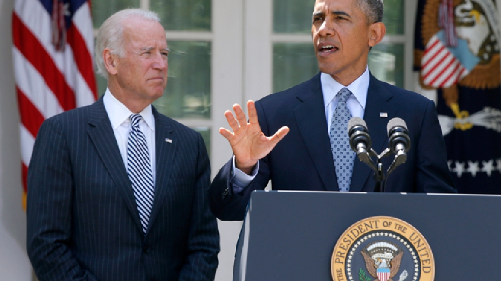 President Barack Obama, accompanied by Vice President Joe Biden, speaks about immigration reform, Monday, June 30, 2014, in the Rose Garden at the White House in Washington. House Speaker John Boehner told President Obama that the House will not vote on overhauling the nation's troubled immigration system during this election year, the White House says. Officials say Obama will announce steps Monday to deal with immigration through executive actions without congressional approval. (AP Photo/Charles Dharapak)