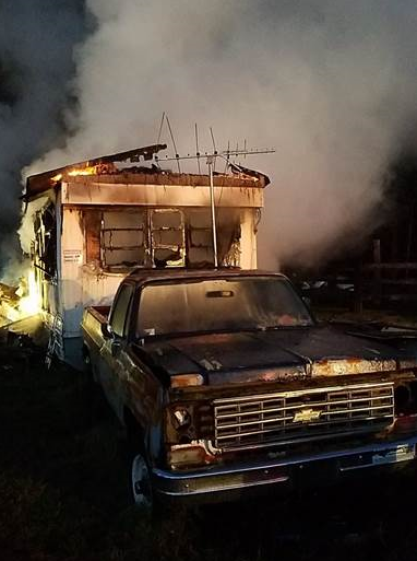 A man is dead after he was found in a burning mobile home in Charles County. (Photo, Charles County Volunteer Fire Department)