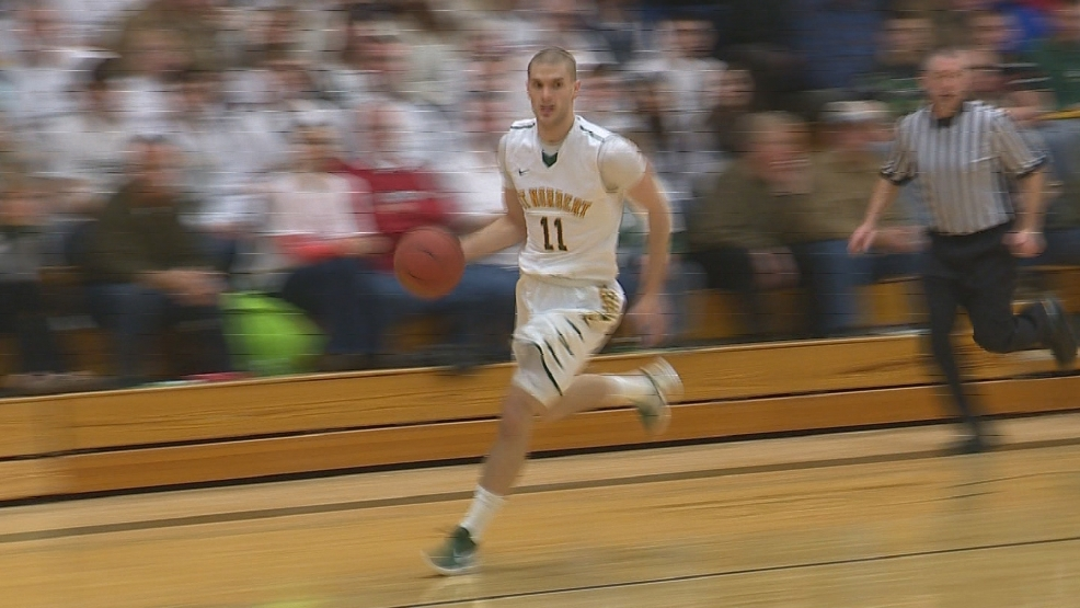 Kam Cerroni of St. Norbert looks to shoot against Grinnell.