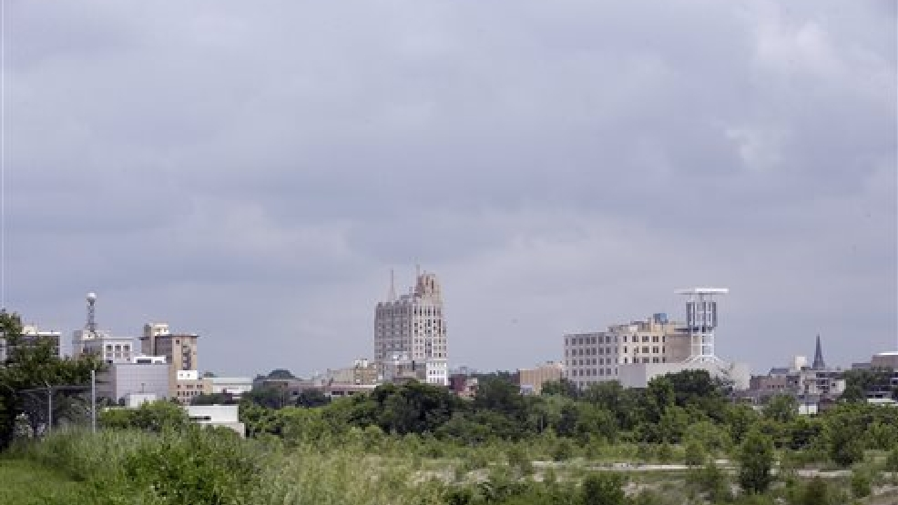 In a June 12, 2014 photo in Flint, Mich., the skyline of the city is seen from the west side. As Detroit hopes to ride out of bankruptcy this year, a smaller Michigan city with a similarly strong bond to the automotive industry soon could drive in. Flint, like its bankrupt big brother an hour's drive south, has suffered a spectacular drop in population and factory jobs with a corresponding rise in property abandonment and crime. (AP Photo/Carlos Osorio)