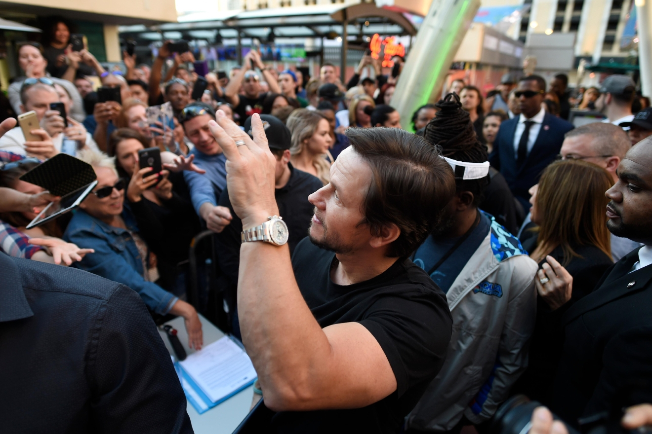 Mark Wahlberg waves to fans as he arrives at a VIP event at Wahlburgers Las Vegas in the Grand Bazaar Shops at Bally's Tuesday, March 28, 2017. [Sam Morris/Las Vegas News Bureau]