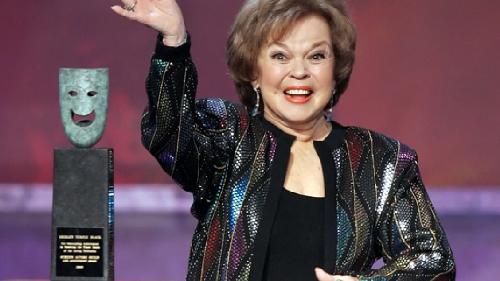 In this Jan. 29, 2006 file photo, Shirley Temple Black accepts the Screen Actors Guild Awards life achievement award at the 12th Annual Screen Actors Guild Awards, in Los Angeles. (AP Photo/Mark J. Terrill, File)
