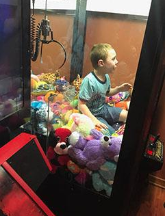(image: Titusville Fire) A Toy Story: Boy rescued from the 'claw' machine