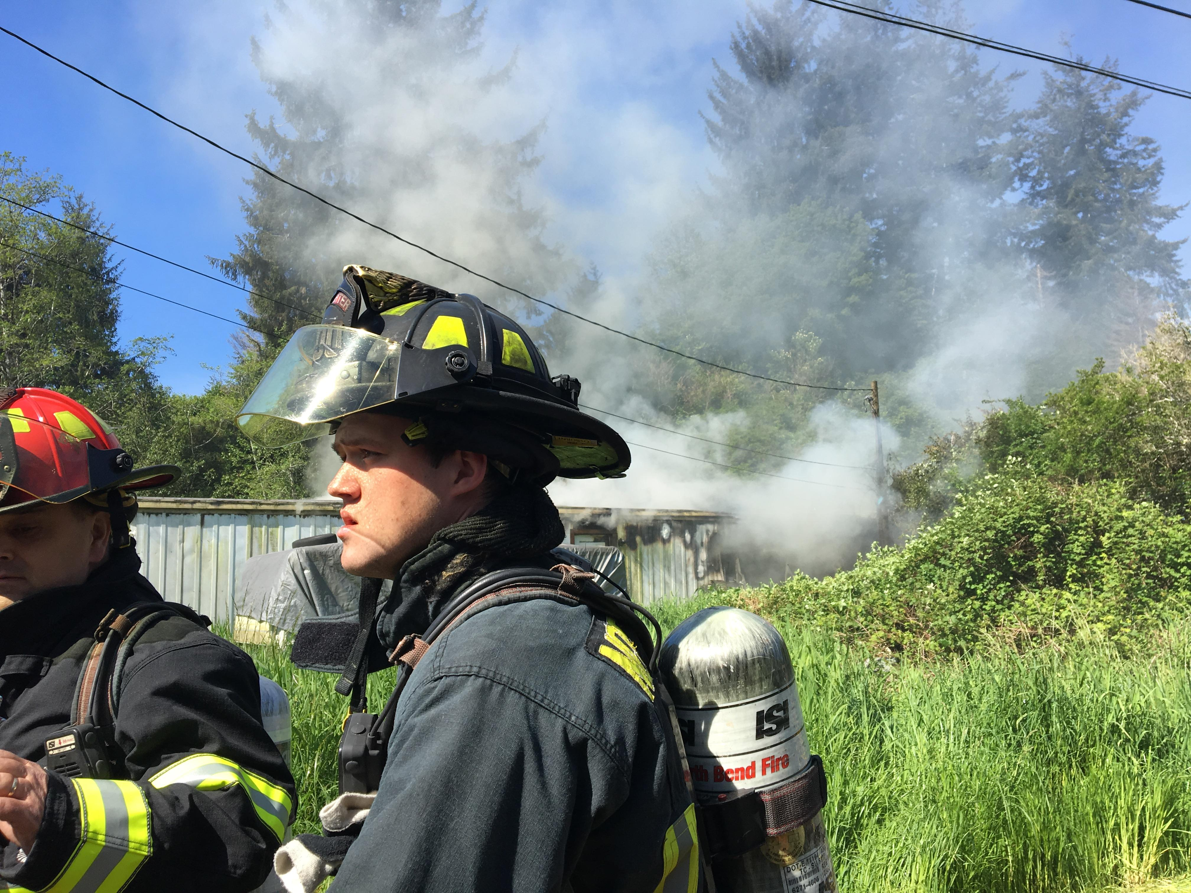 Firefighters battle a house fire on Red Dike Rd in Coos Bay, May 10, 2017. (SBG photo)