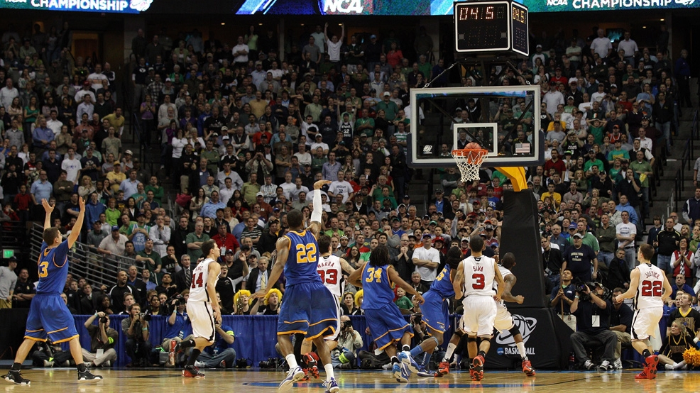 Demonte Harper hits his only 3-pointer of the game to give Morehead State a 62-61 victory against Louisville in the first round of the NCAA Tournament on March 17, 2011, at Pepsi Center in Denver. (Photo by Justin Edmonds/Getty Images)