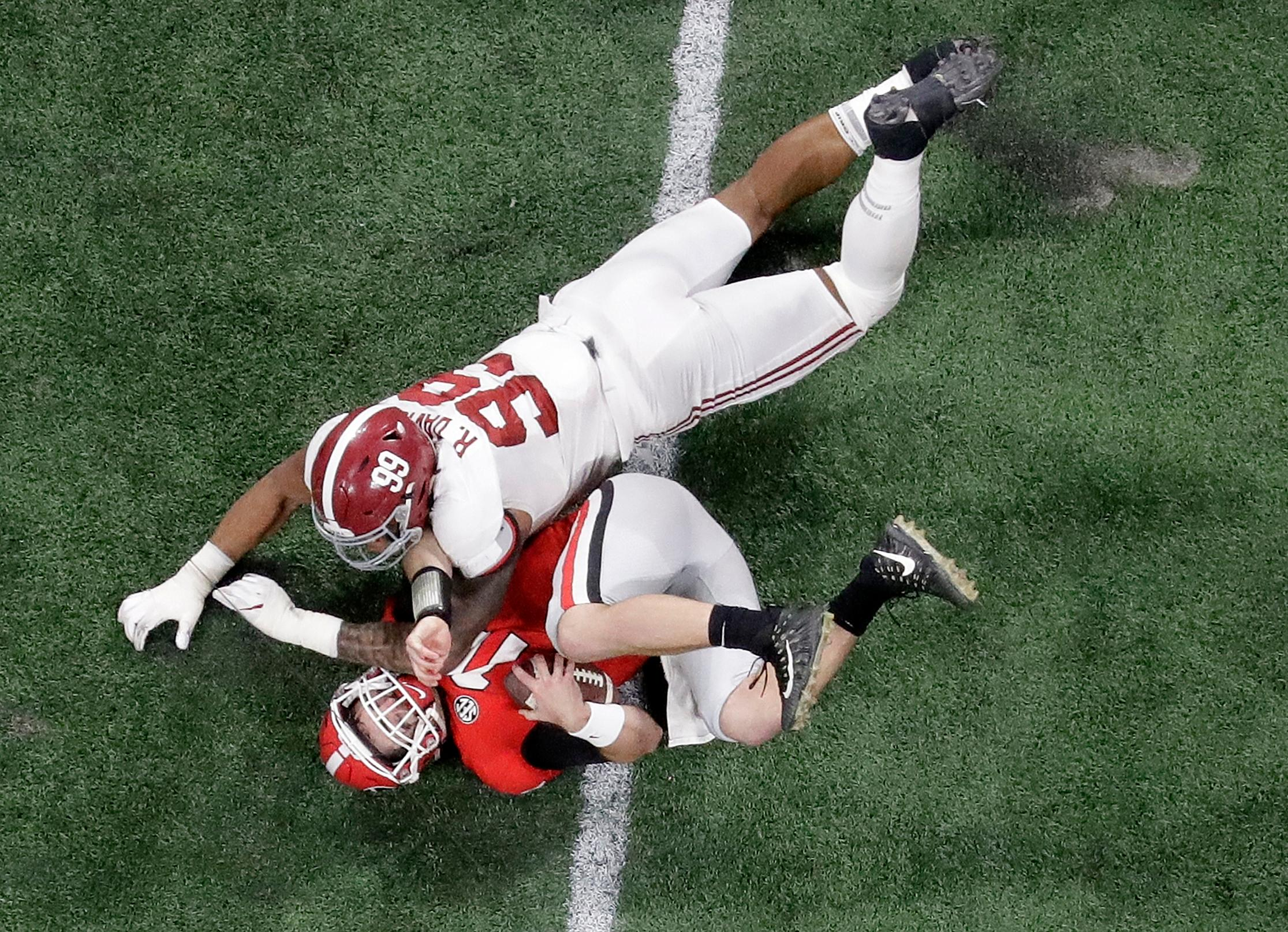 Alabama's Raekwon Davis sacks Georgia's Jake Fromm during the second half of the NCAA college football playoff championship game Monday, Jan. 8, 2018, in Atlanta. (AP Photo/John Bazemore)