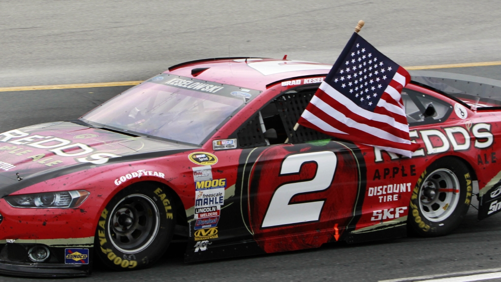 Brad Keselowski celebrates after winning the NASCAR Sprint Cup Series auto race at New Hampshire Motor Speedway on Sunday, July 13, 2014, in Loudon, N.H. (AP Photo/Jim Cole)