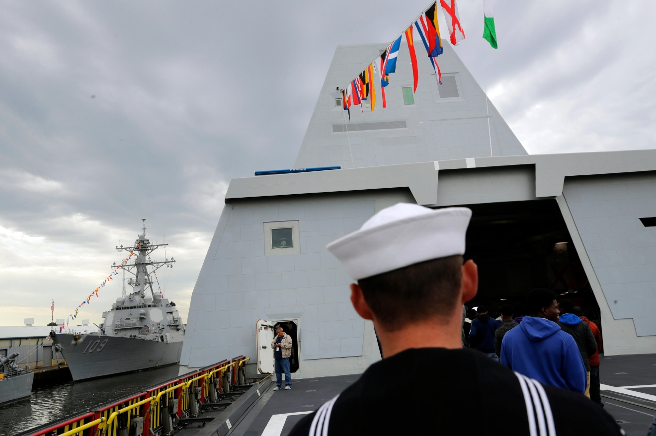 In this Oct. 13, 2016 photo, a sailor walks on the deck of the USS Zumwalt, the U.S. Navy's newest guided-missile destroyer, in Baltimore.   The destroyer's commissioning ceremony is set for Oct. 15 in Baltimore, and its home port will be in San Diego.  (AP Photo/Patrick Semansky)