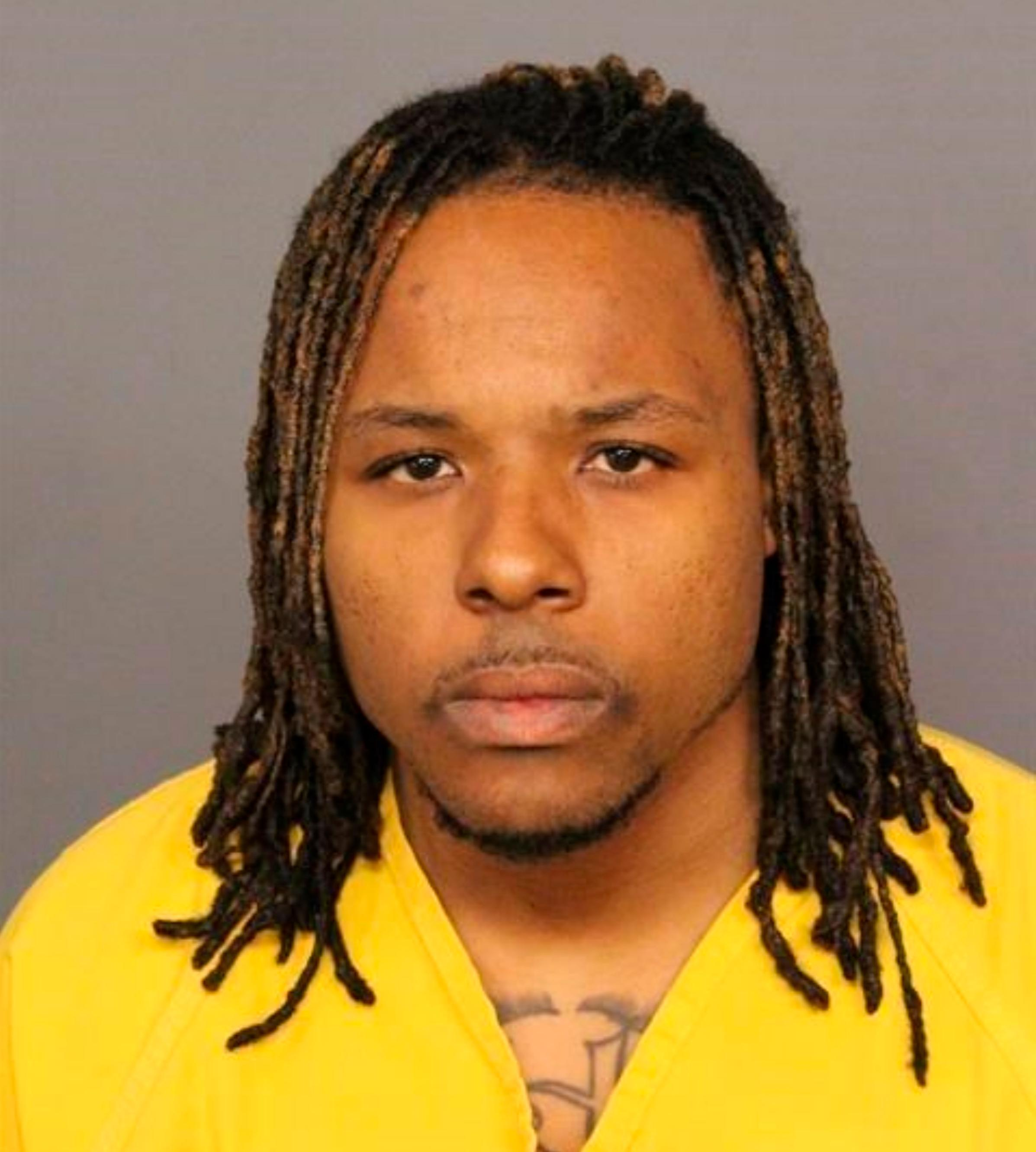 This booking image provided by the Denver Police Department, shows Michael Andre Hancock, who was arrested Friday, June 1, 2018, on suspicion of first-degree murder in the shooting on an interstate. (Denver Police Department via AP)