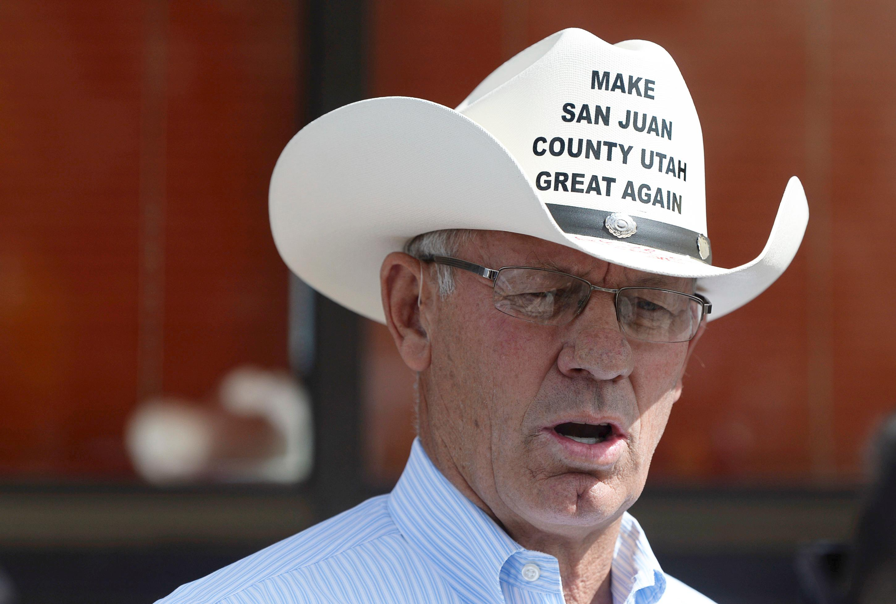 Bruce Adams, chairman of the San Juan County Commission, makes it clear where he stands on the recently designated Bears Ears National Monument designation. Adams arrived at the Blanding airport on Monday, May 8, 2017, to greet Interior Secretary Ryan Zinke as he arrived for an aerial tour of the recently designated Bears Ears National Monument in southeastern Utah. Utah Republicans in Congress are advocating for Trump to jettison Utah's national monument designation.  (Francisco Kjolseth/The Salt Lake Tribune via AP)