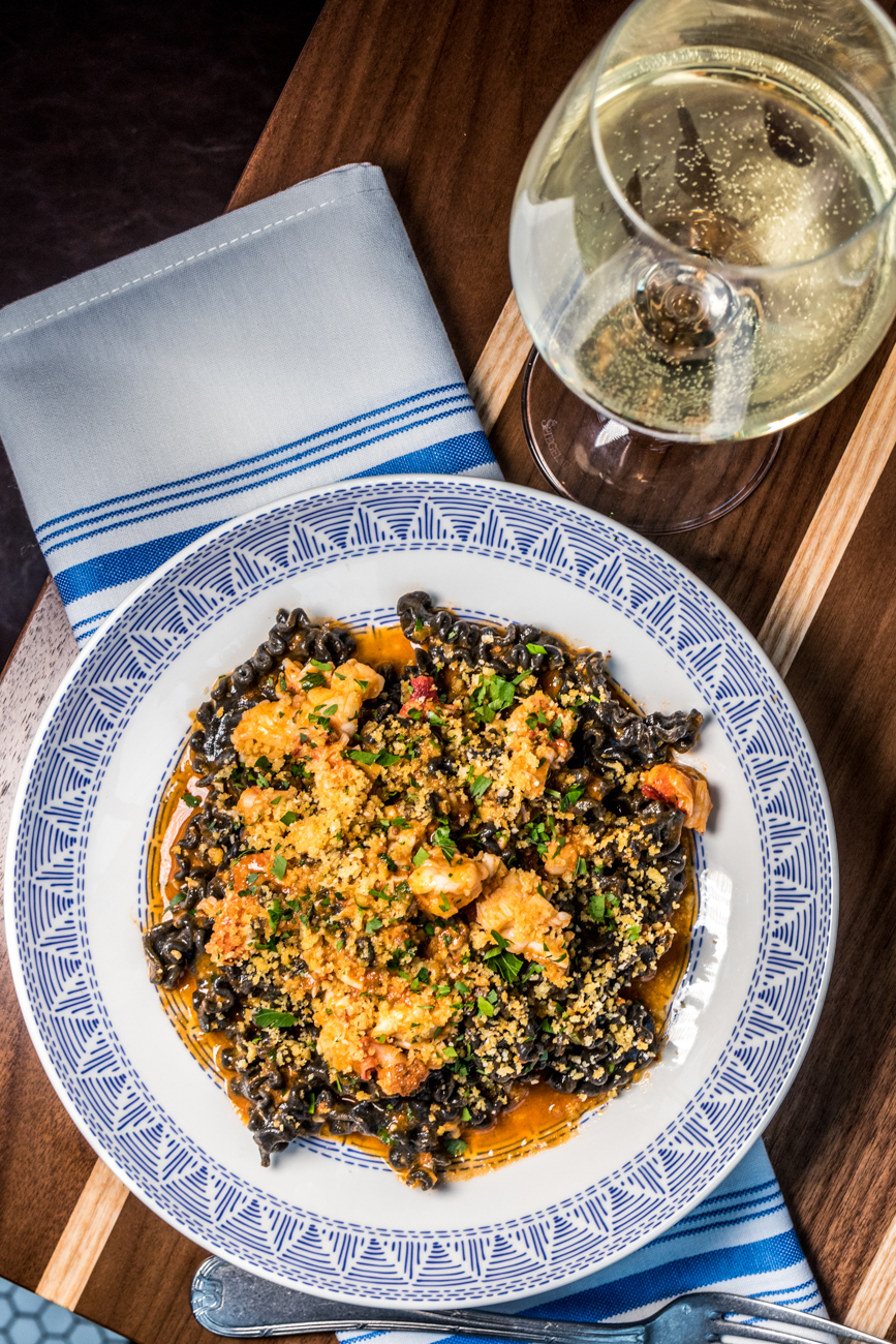 Lobster Pasta: squid ink fusilli pasta, lobster, La Quercia nduja, lobster broth, and garlic breadcrumbs paired with the house white wine / Image: Catherine Viox{ }// Published: 2.11.20
