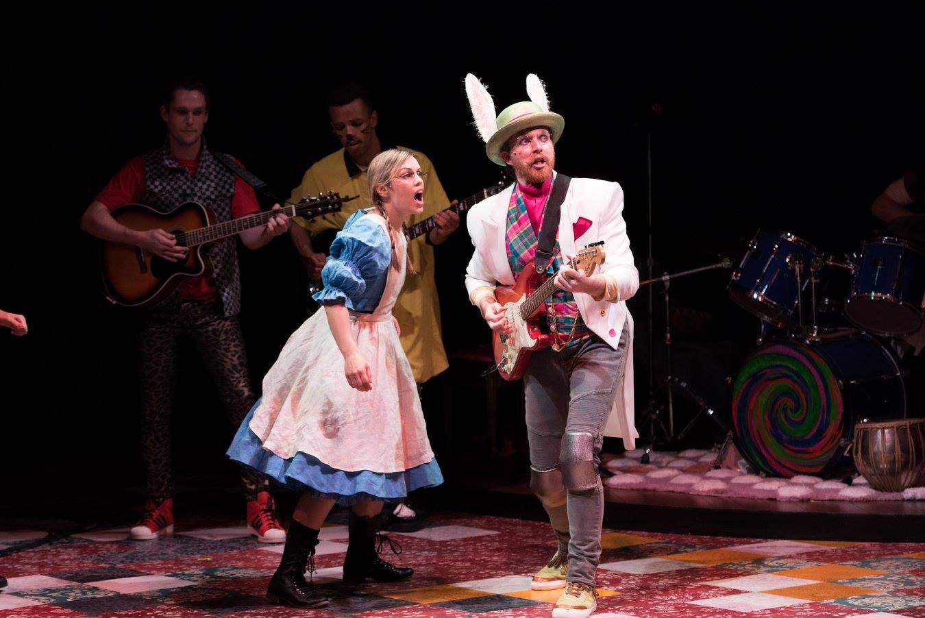 Alice meets the White Rabbit, who is very late! Wonderland: Alice's Rock and Roll Adventure, Imagination Stage (L-R: Erin Weaver, Matthew Aldwin McGee, Ensemble) (Image: Margot Schulman)