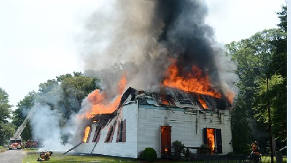 Firefighters from 4 counties and two states battle the fire at St. Pauls Episcopal Church in Hebron, Md., Tuesday, July 22, 2014. The church built in 1773 was on the National Register of Historic Places. (AP Photo/The Daily Times, Todd Dudek)