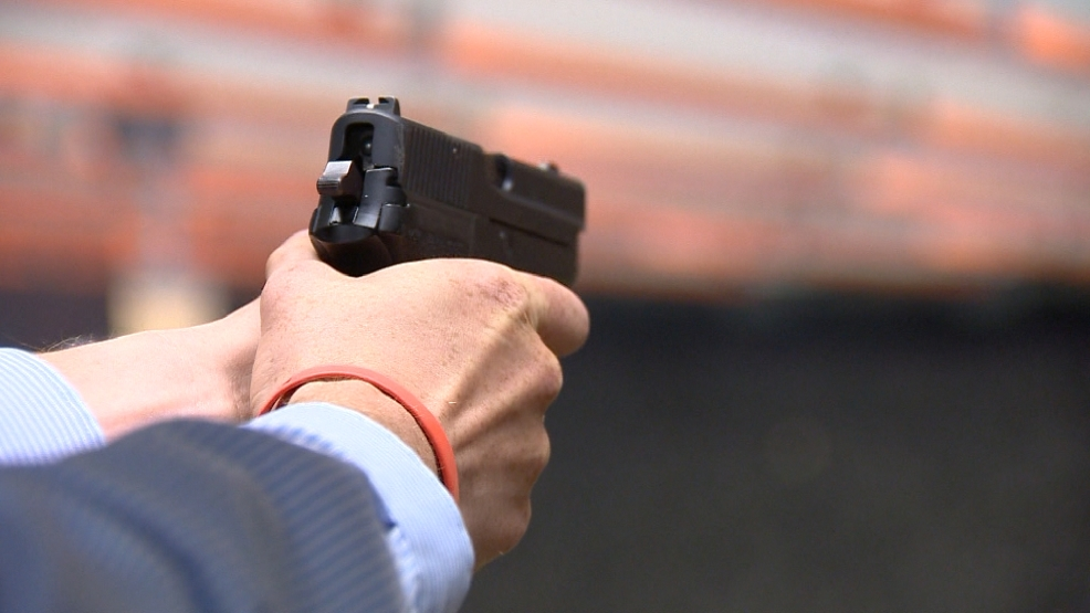 A 9 mm handgun is used.