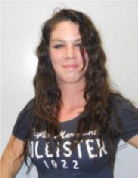 "The Waynesville Police Department is asking for the public's assistance in locating one other person of interest in this investigation. April C. Moore is a 25-year-old white woman, 5'5"" and 110 pounds, with brown eyes and brown hair. Police say she may be known by other names including April Tsoy and April Price. (Photo credit: Waynesville Police Department)"