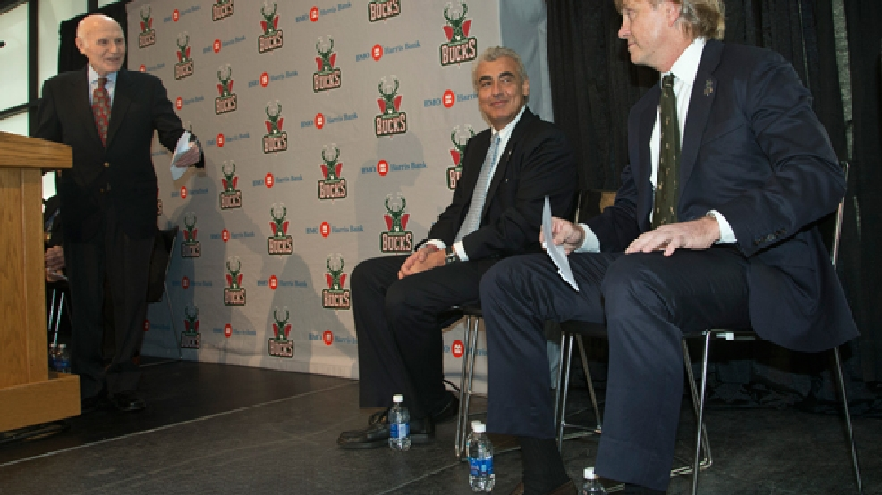 Milwaukee Bucks owner Herb Kohl introduces investment firm executives Marc Lasry, center, and Wesley Edens right, at a news conference after reaching a deal to sell the franchise Wednesday, April 16, 2014, in Milwaukee. The deal is subject to approval by the NBA and its Board of Governors. (AP Photo/Morry Gash)