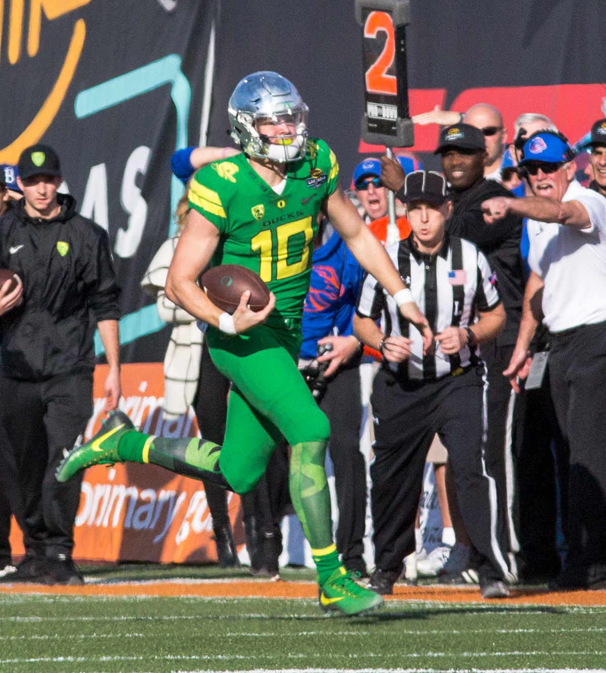 Oregon quarterback Justin Herbert runs the ball. The Boise State Broncos defeated the Oregon Ducks 38 to 28 in the 2017 Las Vegas Bowl at Sam Boyd Stadium in Las Vegas, Nevada on Saturday December 17, 2017. The Las Vegas Bowl served as the first test for Oregon's new Head Coach Mario Cristobal following the loss of former Head Coach Willie Taggart to Florida State University earlier this month. Photo by Ben Lonergan, Oregon News Lab