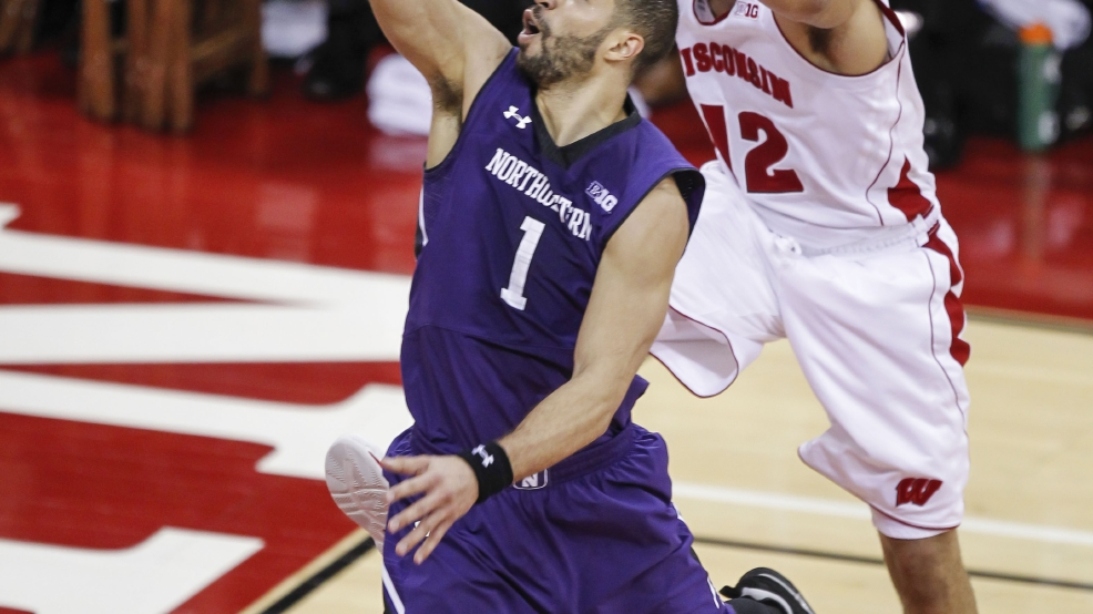 Northwestern's Drew Crawford (1) shoots against Wisconsin's Traevon Jackson during the second half of an NCAA college basketball game Wednesday, Jan. 29, 2014, in Madison, Wis. (AP Photo/Andy Manis)
