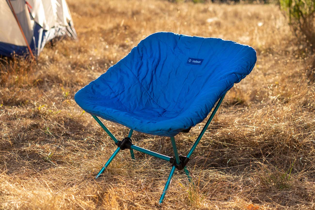 "Regular camp chair not toasty enough for you? Warm it up with this seat cover. The Helinox Seat Warmer is made of synthetic down and fits Helinox' Chair Zero, Chair One, and Swivel Chair. /{&nbsp;}<a  href=""https://helinox.com/"" target=""_blank"" title=""https://helinox.com/"">Website{&nbsp;}</a>/ Price: $39.95 / Image courtesy of Helinox // Published: 12.6.20"