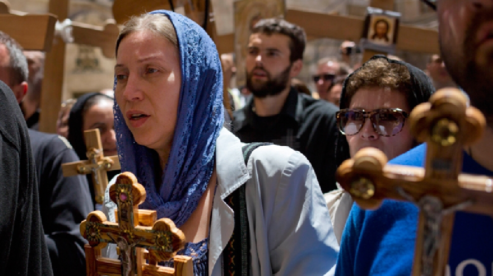 Pilgrims carry crosses during Good Friday in Jerusalem Friday, April 18, 2014, as Christians commemorated the crucifixion of Jesus Christ. (AP Photo/Dusan Vranic)