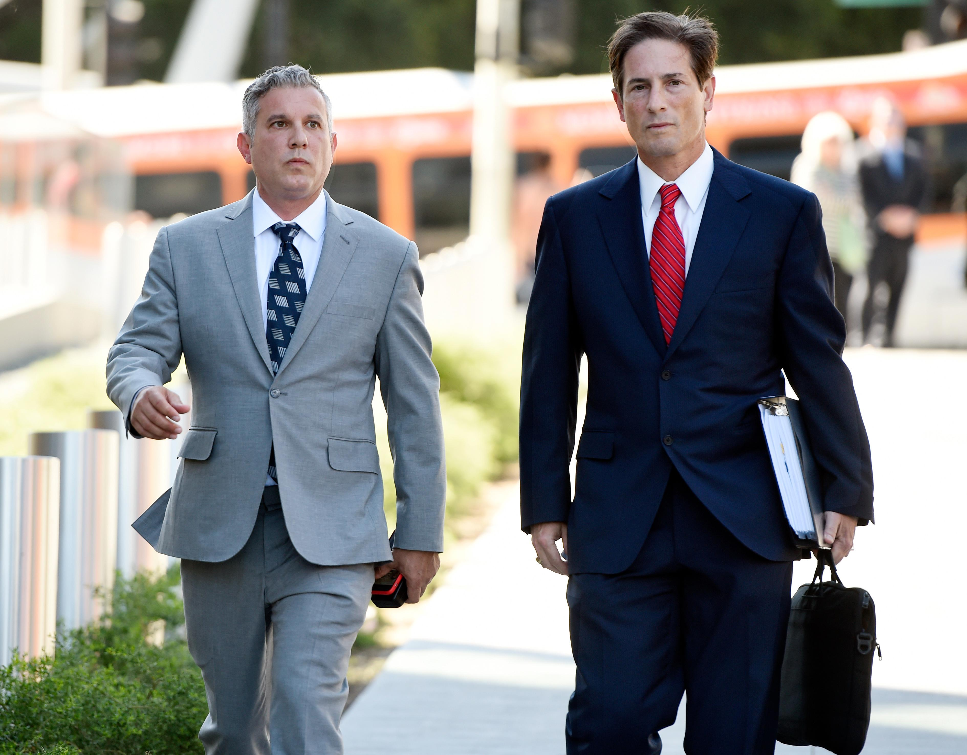 Jonathan Todd Schwartz, left, former business manager for singer Alanis Morissette, arrives with his attorney Nathan Hoffman at U.S. federal court for the sentencing in his embezzlement case, Wednesday, May 3, 2017, in Los Angeles. Schwartz pleaded guilty earlier this year after admitting he embezzled more than $7 million from the singer and other celebrities. (AP Photo/Chris Pizzello)
