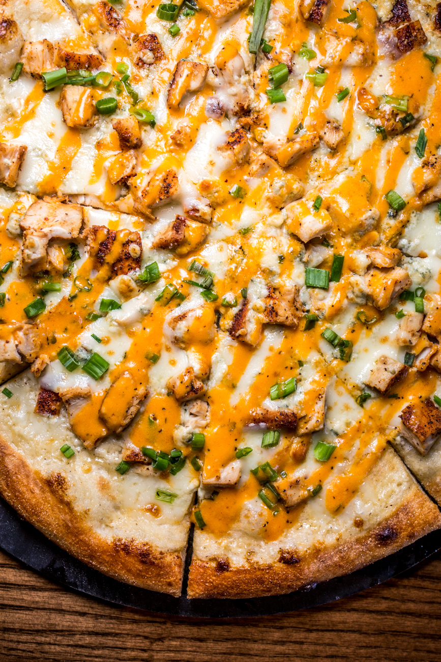 Buffalo chicken pizza: ranch, roasted chicken, bleu cheese, green onion, house cheese, and buffalo sauce drizzle / Image: Catherine Viox{ }// Published: 11.10.19