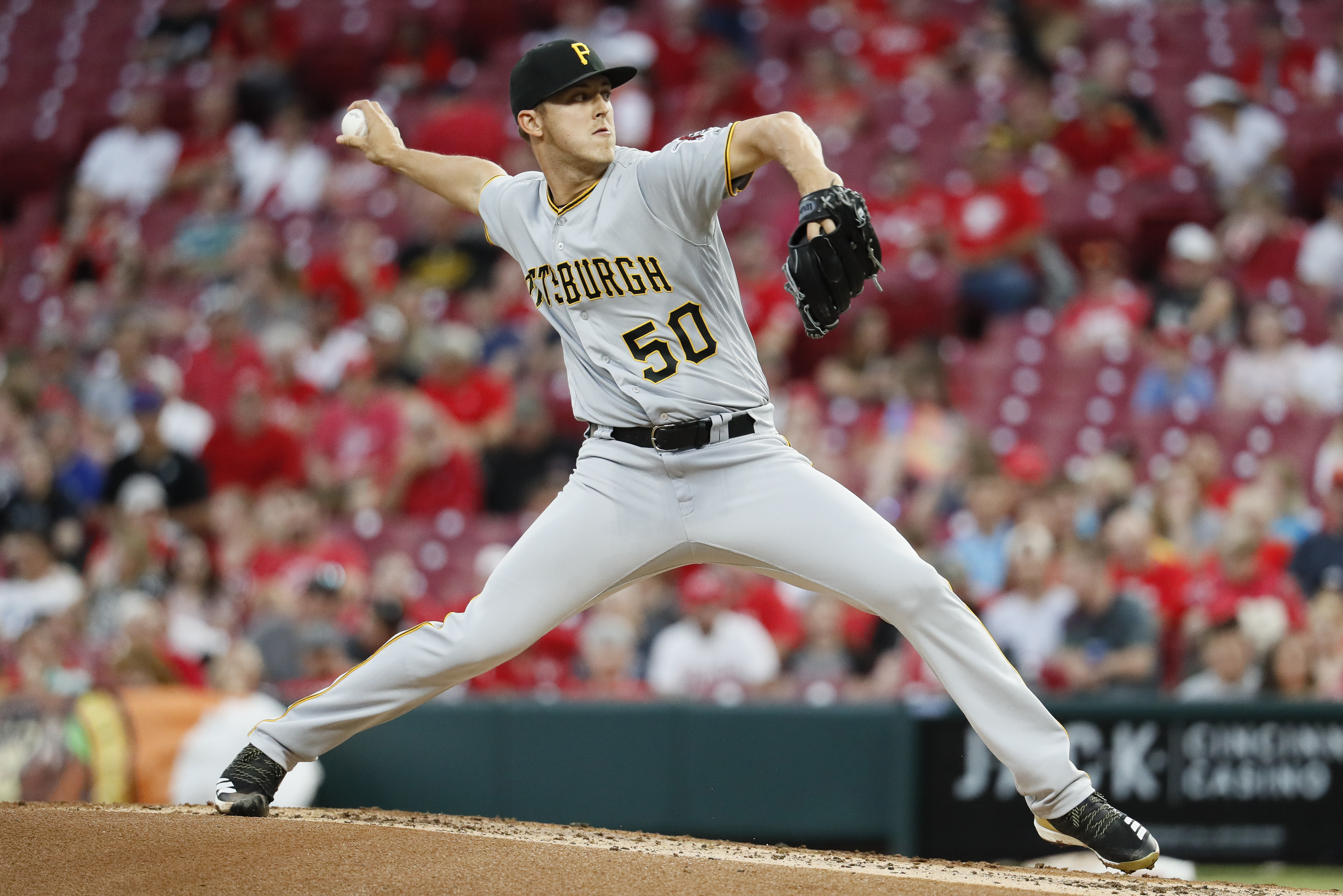 Pittsburgh Pirates starting pitcher Jameson Taillon throws during the first inning of a baseball game against the Cincinnati Reds, Tuesday, May 22, 2018, in Cincinnati. (AP Photo/John Minchillo)