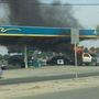 Parlier Police cruiser pushes burning truck away from gas pumps