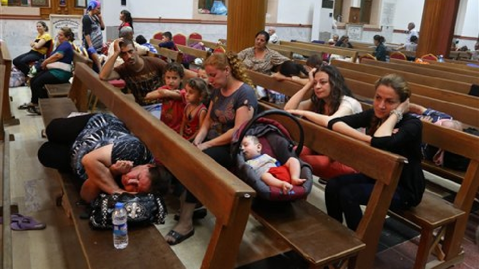 Displaced Iraqi Christians settle at St. Joseph Church in Irbil, northern Iraq, Thursday, Aug. 7, 2014. Late Wednesday, militants overran a cluster of predominantly Christian villages alongside the country's semi-autonomous Kurdish region, sending tens of thousands of civilians and Kurdish fighters fleeing from the area, several priests in northern Iraq said Thursday. (AP Photo/Khalid Mohammed)