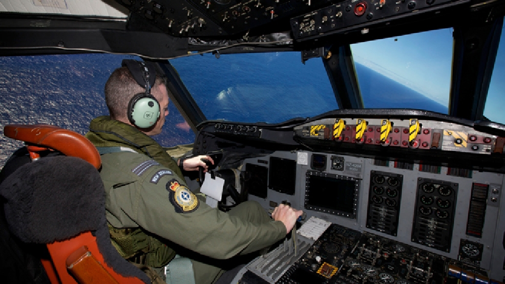 Captain Flt. Lt. Tim McAlevey of the Royal New Zealand Air Force flies a P-3 Orion in search for the missing Malaysia Airlines Flight 370 over the Indian Ocean, Friday, April 11, 2014. (AP Photo/Richard Wainwright, Pool)