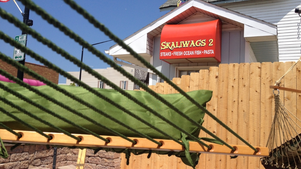 The city of Algoma is seeing new businesses pop up or expand in its downtown. A hammock from Comfortably Numb is seen with the sign of recently-expanded restaurant Skaliwags 2 in the background.