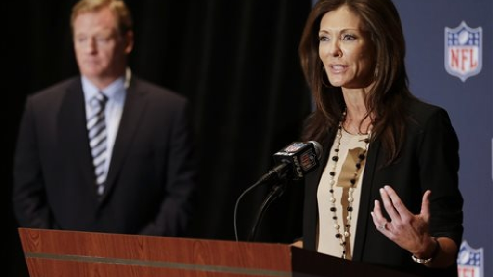 NFL Foundation Chair Charlotte Jones Anderson, right, speaks during a news conference to support the growth of youth football as NFL Commissioner Roger Goodell, left, listens at the NFL annual meeting in Orlando, Fla., Monday, March 24, 2014. The NFL Foundation is giving USA Football a five-year, $45 million grant to expand the already burgeoning Heads Up Football program that teaches safe tackling to youngsters. (AP Photo/John Raoux)