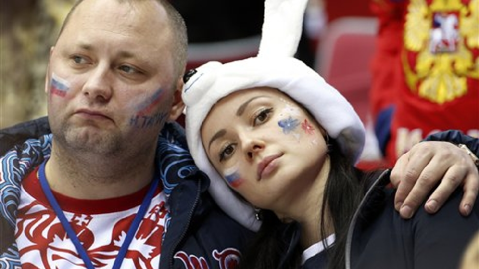 Russian hockey fans react at the end of a men's quarterfinal ice hockey game between Finland and Russia at the 2014 Winter Olympics, Wednesday, Feb. 19, 2014, in Sochi, Russia. Finland won 3-1. (AP Photo/Julio Cortez)