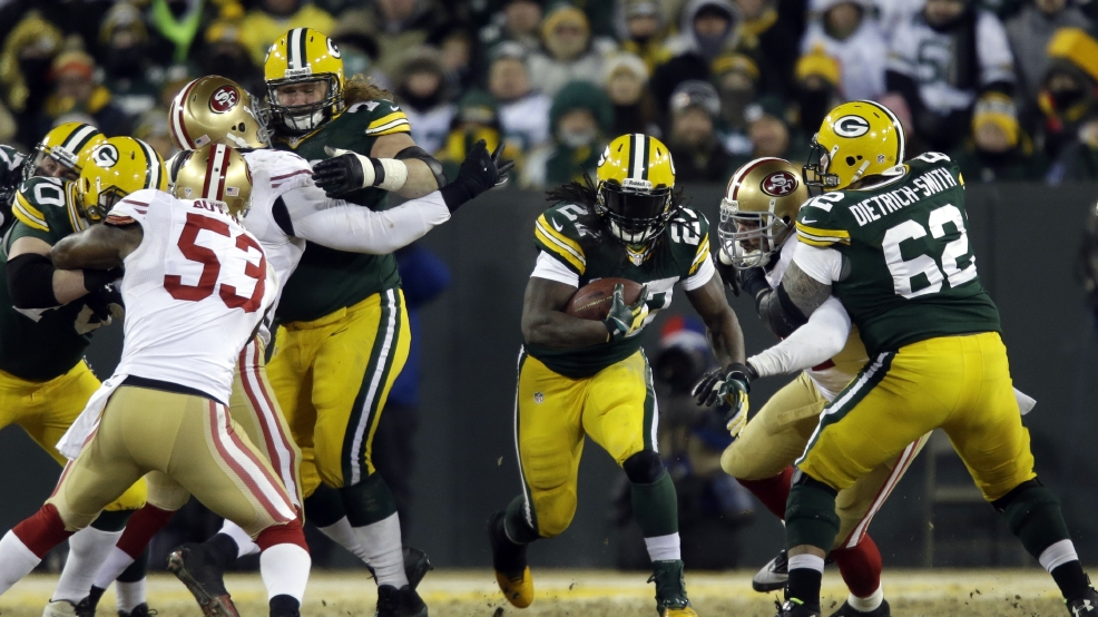 Green Bay Packers running back Eddie Lacy (27) rushes against San Francisco 49ers defense during the second half of an NFL wild-card playoff football game, Sunday, Jan. 5, 2014, in Green Bay. (AP Photo/Jeffrey Phelps)