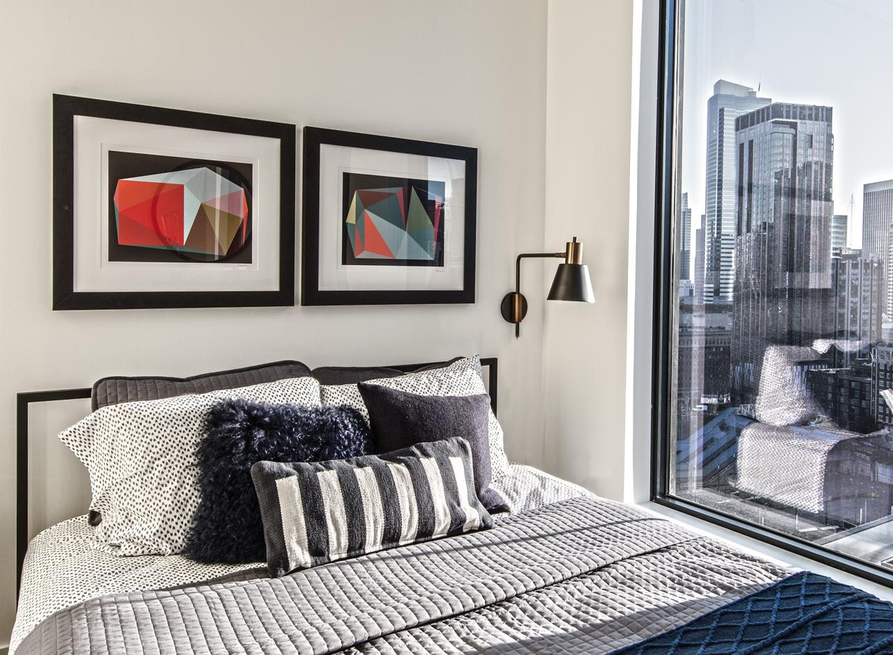 A bedroom in a two bedroom apartment at AMLI Arc<p></p>