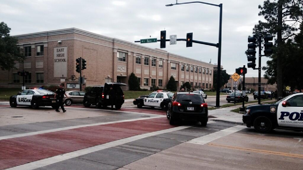 Police vehicles surround Green Bay East High School, June 23, 2014. (WLUK/Bill Miston)