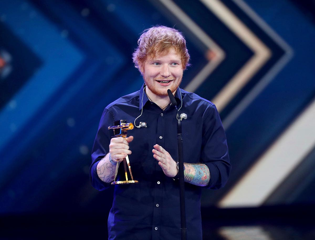In this March 4, 2017 picture,  British singer Ed Sheeran  poses with his Golden Camera award  at the 52nd Golden Camera film & TV awards 2017 in Hamburg, Germany. (Christian Charisius/Pool Photo via AP)