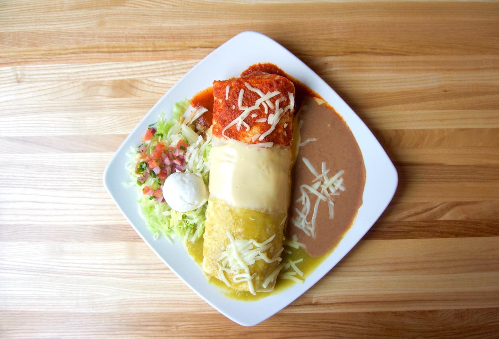 <p>Burrito Mexicano: stuffed with grilled chicken, chorizo, grilled onions, jalapeno peppers, tomato, and cheese, topped with green sauce, cheese sauce, and red sauce, and served with beans, rice, lettuce, pico de gallo, and sour cream / Image: Brian Planalp // Published: 1.29.18</p>