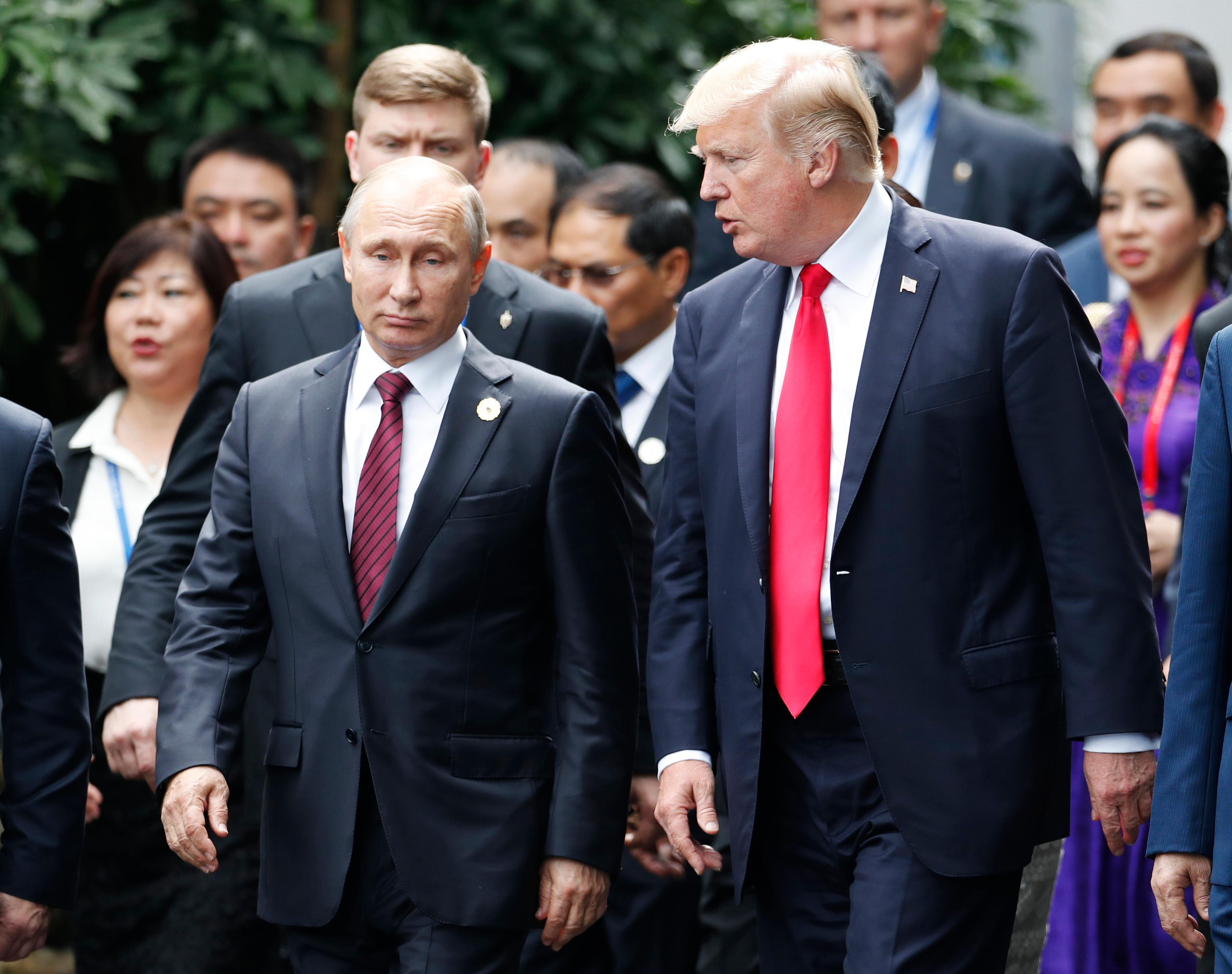 U.S. President Donald Trump, right, and Russia's President Vladimir Putin talk during the family photo session at the APEC Summit in Danang, Vietnam Saturday, Nov. 11, 2017. (Jorge Silva/Pool Photo via AP)<p></p>