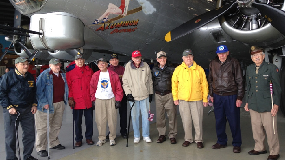 "World War II veterans pose in front of the EAA's B-17 bomber ""Aluminum Overcast,"" April 14, 2014. (WLUK/Chad Doran)"