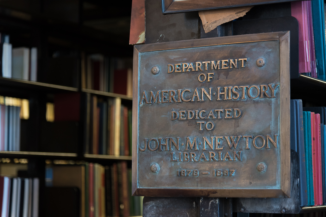 John M. Newtown (librarian from 1878-1897) was one of the organization's most beloved servants. He died at his desk in the library on December 9th, 1897. It is said that the glasses didn't even fall from his nose due to how quietly he passed away. A plaque hangs near the librarian's office on the stacks to commemorate his service. / Image: Phil Armstrong, Cincinnati Refined // Published: 2.7.18
