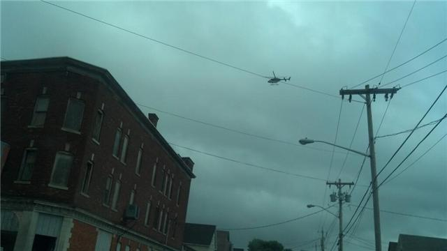 State Police helicopter circling over Utica neighborhood on the third day of search for Levon Wameling
