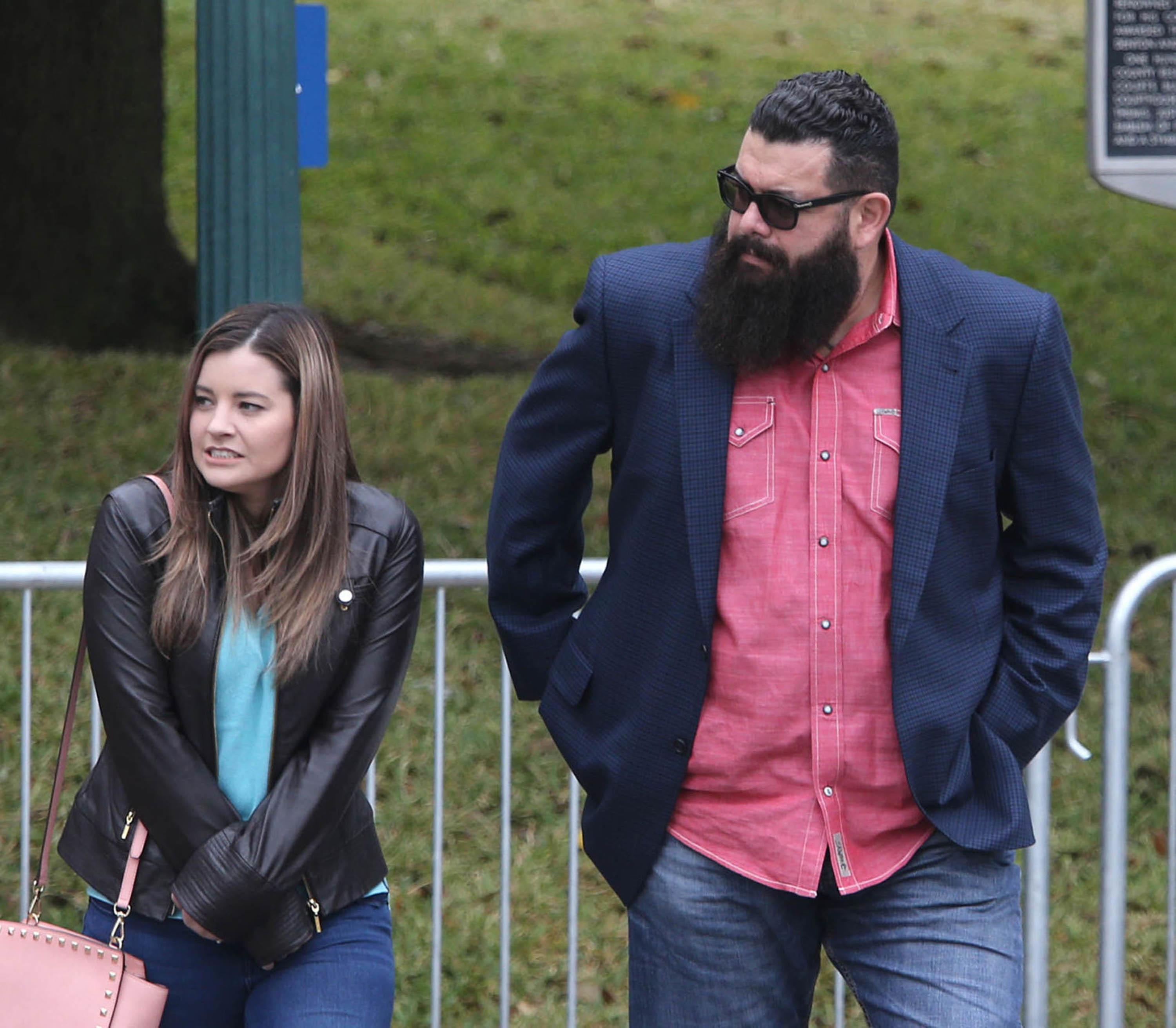 "Christopher ""Jake"" Carrizal, right, arrives at the McLennan County courthouse with an unidentified women, Thursday, Nov. 9, 2017, in Waco, Texas. A jury started deliberating around noon after both sides of the case presented closing arguments. The Dallas chapter president of the Bandidos motorcycle club is the first to stand trial involving the 2015 shootout where nine people were fatally shot and 18 people were injured outside of Twin Peaks restaurant. (Jerry Larson/Waco Tribune Herald, via AP)"